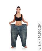 Купить «Slim woman with huge pants», фото № 10965264, снято 23 мая 2018 г. (c) PantherMedia / Фотобанк Лори