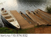 Купить «Dugout Canoes waiting at the Dock», фото № 10974932, снято 25 апреля 2019 г. (c) PantherMedia / Фотобанк Лори