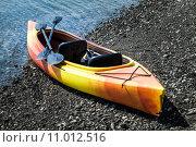 Купить «Orange and Yellow Kayak With Oars on the Sea Shore», фото № 11012516, снято 19 декабря 2018 г. (c) PantherMedia / Фотобанк Лори