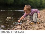Купить «Boy playing at River», фото № 11054256, снято 25 мая 2020 г. (c) PantherMedia / Фотобанк Лори