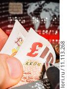Купить «Coins, credit cards and british pounds on newspaper», фото № 11113268, снято 22 июля 2019 г. (c) PantherMedia / Фотобанк Лори