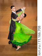 Купить «Competitors dancing slow waltz on  the dance conquest», фото № 11166708, снято 25 марта 2019 г. (c) PantherMedia / Фотобанк Лори