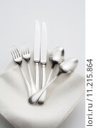 Купить «closeup of silverware on pile of plates with white cloth», фото № 11215864, снято 20 сентября 2019 г. (c) PantherMedia / Фотобанк Лори