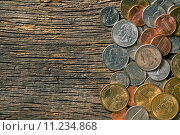 Купить «U.S. coins on old wooden background», фото № 11234868, снято 22 июля 2019 г. (c) PantherMedia / Фотобанк Лори