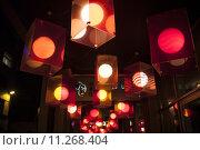 Купить «Red lanterns above entrance to the shop.», фото № 11268404, снято 27 июня 2019 г. (c) PantherMedia / Фотобанк Лори