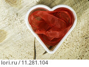 Купить «Heart shape made of red textile», фото № 11281104, снято 20 октября 2018 г. (c) PantherMedia / Фотобанк Лори