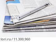 Купить «stack print news reads penholders», фото № 11300960, снято 16 июля 2019 г. (c) PantherMedia / Фотобанк Лори