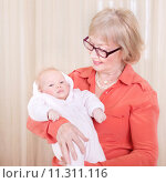 Купить «Happy granny holding newborn child», фото № 11311116, снято 6 мая 2020 г. (c) PantherMedia / Фотобанк Лори