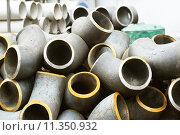 Купить «Трубы и отводы стальные», фото № 11350932, снято 8 февраля 2014 г. (c) Сергеев Валерий / Фотобанк Лори