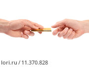 Купить «Hand gives credit card to another hand», фото № 11370828, снято 25 апреля 2018 г. (c) PantherMedia / Фотобанк Лори
