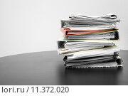 Купить «stack of folders and documents on office table», фото № 11372020, снято 24 мая 2018 г. (c) PantherMedia / Фотобанк Лори