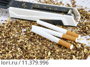 Купить «cigarette tube and hand held injector», фото № 11379996, снято 8 июля 2020 г. (c) PantherMedia / Фотобанк Лори