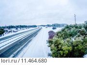 Купить «highway covered in snow and sleet without traffic», фото № 11464680, снято 12 ноября 2019 г. (c) PantherMedia / Фотобанк Лори
