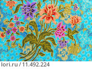 Beautiful colorful flowers on batik background. Стоковое фото, фотограф manus Khomkham / PantherMedia / Фотобанк Лори