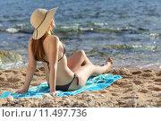 Woman sunbathing on the beach in summer. Стоковое фото, фотограф Antonio Guillen Fernández / PantherMedia / Фотобанк Лори