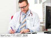 Купить «Young doctor writing medical prescription», фото № 11607364, снято 11 декабря 2018 г. (c) PantherMedia / Фотобанк Лори
