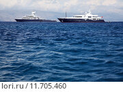 Купить «Gigantic big and large luxury yacht with sail boat and helicopter landing place on bord.», фото № 11705460, снято 19 января 2019 г. (c) PantherMedia / Фотобанк Лори
