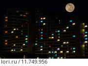 Купить «Full moon over colorful windows of residential house», фото № 11749956, снято 20 июня 2019 г. (c) PantherMedia / Фотобанк Лори