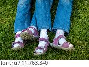 Купить «similar legs in sandals of twin girls», фото № 11763340, снято 21 марта 2019 г. (c) PantherMedia / Фотобанк Лори