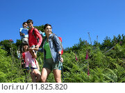 Купить «Family on a hiking day going down hill », фото № 11825820, снято 11 октября 2019 г. (c) PantherMedia / Фотобанк Лори