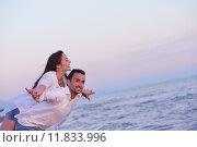 Купить «young couple  on beach have fun», фото № 11833996, снято 5 апреля 2020 г. (c) PantherMedia / Фотобанк Лори