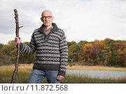 Купить «Mature man holding a stick», фото № 11872568, снято 22 января 2019 г. (c) PantherMedia / Фотобанк Лори