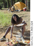 Купить «Family having lunch on camping trip, focus on man cooking food in foreground, smiling, portrait», фото № 11969324, снято 16 июля 2019 г. (c) PantherMedia / Фотобанк Лори