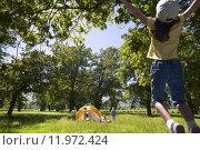 Купить «Family at campsite», фото № 11972424, снято 16 июля 2019 г. (c) PantherMedia / Фотобанк Лори