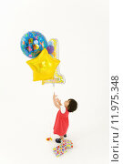 Купить «Toddler girl (9-12 months) with baloons, elevated view », фото № 11975348, снято 22 мая 2018 г. (c) PantherMedia / Фотобанк Лори