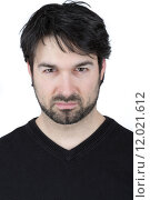 portrait of a man looking angry before white background. Стоковое фото, фотограф Armin Burkhardt / PantherMedia / Фотобанк Лори