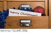 Купить «Christmas gifts in the drawer of a cabinet», фото № 12041592, снято 27 мая 2019 г. (c) PantherMedia / Фотобанк Лори