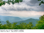 Купить «ridges of theSmokey Mountains extending across the valley on the BLue Ridge Parkway near Cherokee, North Carolina.», фото № 12051056, снято 18 января 2019 г. (c) PantherMedia / Фотобанк Лори