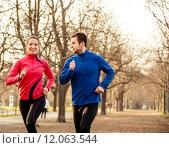 Купить «Couple jogging together», фото № 12063544, снято 22 июля 2019 г. (c) PantherMedia / Фотобанк Лори
