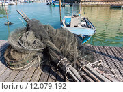 Купить «fishing nets, creels and fishing boats», фото № 12079192, снято 19 ноября 2018 г. (c) PantherMedia / Фотобанк Лори