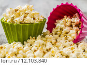 Купить «Pile of Popcorn in Colorful Bowls», фото № 12103840, снято 19 июня 2019 г. (c) PantherMedia / Фотобанк Лори