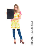 Купить «Beautiful woman with apron and menu bord», фото № 12126672, снято 19 января 2019 г. (c) PantherMedia / Фотобанк Лори