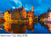 Купить «Cityscape with a tower Belfort from Rozenhoedkaai in Bruges at s», фото № 12162576, снято 24 января 2019 г. (c) PantherMedia / Фотобанк Лори