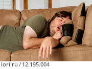 Купить «Man taking a quick nap on the couch», фото № 12195004, снято 16 января 2019 г. (c) PantherMedia / Фотобанк Лори