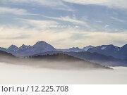 Купить «overlooking the mist-covered isarwinkel», фото № 12225708, снято 17 июля 2019 г. (c) PantherMedia / Фотобанк Лори