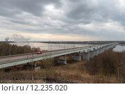 Купить «Длинный автомобильный мост через Волгу, Кинешма-Заволжск», эксклюзивное фото № 12235020, снято 3 мая 2015 г. (c) Дмитрий Неумоин / Фотобанк Лори
