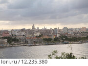 Купить «A panoramic view of Old Havana with the El Capitolio dome and the tower of Jose Marti memorial in the background, Havana, Cuba», фото № 12235380, снято 20 сентября 2019 г. (c) PantherMedia / Фотобанк Лори