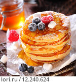 Купить «Delicious breakfast of fruity berry pancakes», фото № 12240624, снято 15 августа 2018 г. (c) PantherMedia / Фотобанк Лори