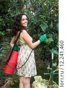 Купить «Woman spraying tree branches», фото № 12241460, снято 11 июля 2020 г. (c) Яков Филимонов / Фотобанк Лори