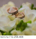 Купить «Two wedding rings in infinity sign. Love concept.», фото № 12258408, снято 18 июля 2018 г. (c) PantherMedia / Фотобанк Лори