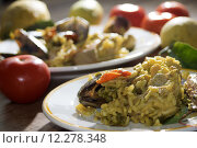 Купить «valenciana paella with some of its traditional ingredients or rather fish vegetable and meat», фото № 12278348, снято 19 марта 2019 г. (c) PantherMedia / Фотобанк Лори