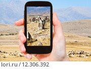 Купить «tourist photographs menhirs Zorats Karer Armenia», фото № 12306392, снято 16 декабря 2018 г. (c) PantherMedia / Фотобанк Лори