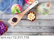 Купить «Aerial Shot of Salad Ingredients on Wooden Table», фото № 12311116, снято 12 декабря 2017 г. (c) PantherMedia / Фотобанк Лори
