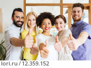 Купить «happy creative team in office», фото № 12359152, снято 29 марта 2015 г. (c) Syda Productions / Фотобанк Лори