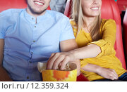 Купить «happy couple watching movie in theater or cinema», фото № 12359324, снято 19 января 2015 г. (c) Syda Productions / Фотобанк Лори