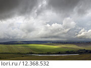Купить «Farmland and lake during storm weather», фото № 12368532, снято 25 мая 2018 г. (c) PantherMedia / Фотобанк Лори